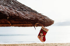 Natale che immagazzina sulla spiaggia Fotografie Stock Libere da Diritti
