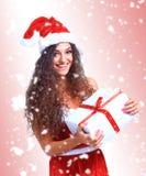 Natale della tenuta del ritratto della donna di Santa di Natale Fotografia Stock