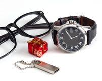 Natale di affari: vetri, orologi del ` s degli uomini Immagini Stock