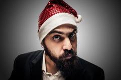 Natale elegante moderno dubbioso di babbo del Babbo Natale Fotografia Stock
