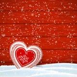 Natale motore nel cuore decorato rosso e bianco scandinavo di stile, davanti alla parete di legno, illustrazione Fotografie Stock