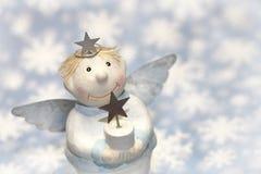 Natale o angelo custode blu con i fiocchi di neve per la decorazione Fotografia Stock Libera da Diritti