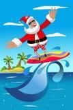 Natale Santa Claus Surfing Tropical Sea Fotografie Stock Libere da Diritti