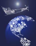 Natale Santa in slitta con la renna sopra terra Immagine Stock
