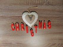 Natale scritto con la decorazione Fotografie Stock