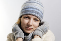Natali. Portrait of the young woman, blue scarf and cap, white woolen sweater, blue eyes Stock Photos