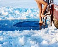 Natação do furo do gelo Imagem de Stock