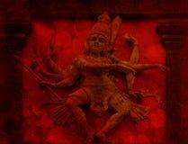 Nataraj танцуя Grunge красного цвета статуи сброса стены Shiva Стоковые Фотографии RF