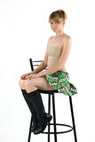 Natasha. Young attractive girl sitting on a bar chair in studio Royalty Free Stock Photos