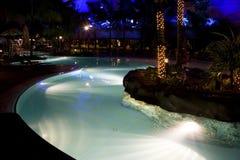 natation de regroupement de nuit Photographie stock libre de droits