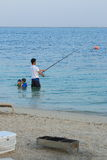 Natation et pêche Photo stock