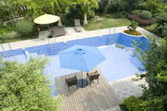 Natatorium. The luxurious villa garden swimming pool stock photos