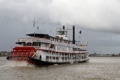 Natchez steamboat. NEW ORLEANS, LOUISIANA, May 6, 2015 : Natchez steamboat leaves the port of New Orleans. Natchez has been the name of several steamboats, and stock photos