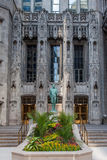 Nathan Hale Statue Tribune Tower Chicago. The Nathan Hale statue on a blooming garden in front of the adorned Tribune Tower in Michigan Avenue, magnificent mile Stock Photo