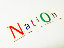 Nation - Cutout Words Collage Of Mixed Magazine Letters with White Background. Caption composed with letters torn from magazines with White Background Stock Images