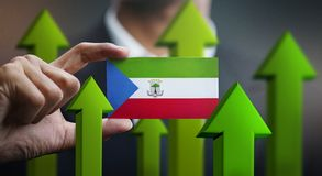 Nation Growth Concept, Green Up Arrows - Businessman Holding Car. D of Equatorial Guinea Flag stock illustration