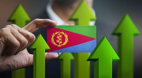 Nation Growth Concept, Green Up Arrows - Businessman Holding Car. D of Eritrea Flag royalty free illustration
