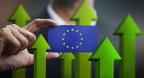 Nation Growth Concept, Green Up Arrows - Businessman Holding Car. D of European Flag vector illustration