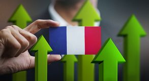 Nation Growth Concept, Green Up Arrows - Businessman Holding Car. D of France Flag royalty free illustration