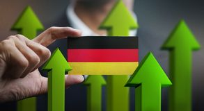 Nation Growth Concept, Green Up Arrows - Businessman Holding Car. D of Germany Flag royalty free illustration