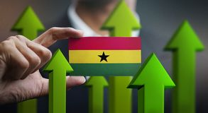 Nation Growth Concept, Green Up Arrows - Businessman Holding Car. D of Ghana Flag royalty free illustration