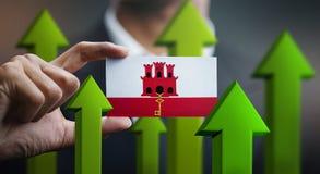Nation Growth Concept, Green Up Arrows - Businessman Holding Car. D of Gibraltar Flag stock illustration