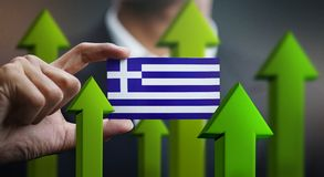 Nation Growth Concept, Green Up Arrows - Businessman Holding Car. D of Greece Flag royalty free illustration
