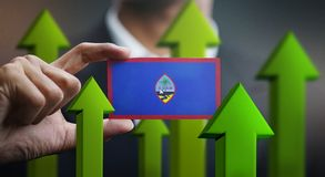 Nation Growth Concept, Green Up Arrows - Businessman Holding Car. D of Guam Flag stock illustration