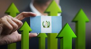 Nation Growth Concept, Green Up Arrows - Businessman Holding Car. D of Guatemala Flag stock illustration