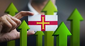 Nation Growth Concept, Green Up Arrows - Businessman Holding Car. D of Guernsey Flag royalty free illustration