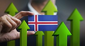 Nation Growth Concept, Green Up Arrows - Businessman Holding Car. D of Iceland Flag vector illustration