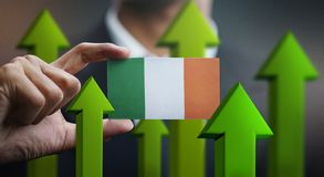 Nation Growth Concept, Green Up Arrows - Businessman Holding Car. D of Ireland Flag stock illustration