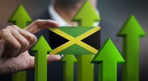 Nation Growth Concept, Green Up Arrows - Businessman Holding Car. D of Jamaica Flag stock illustration