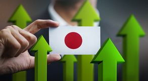 Nation Growth Concept, Green Up Arrows - Businessman Holding Car. D of Japan Flag stock illustration
