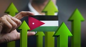 Nation Growth Concept, Green Up Arrows - Businessman Holding Car. D of Jordan Flag vector illustration