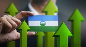 Nation Growth Concept, Green Up Arrows - Businessman Holding Car. D of Kabardino-Balkaria Flag vector illustration