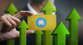 Nation Growth Concept, Green Up Arrows - Businessman Holding Car. D of Kalmykia Flag stock illustration