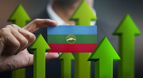 Nation Growth Concept, Green Up Arrows - Businessman Holding Car. D of Karachay-Cherkessia Flag stock illustration