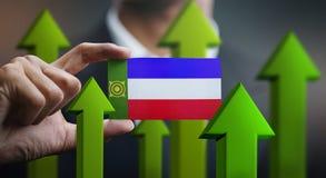 Nation Growth Concept, Green Up Arrows - Businessman Holding Car. D of Khakassia Flag vector illustration