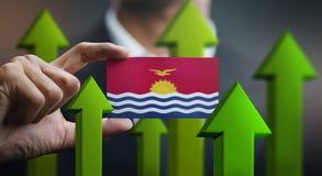 Nation Growth Concept, Green Up Arrows - Businessman Holding Car. D of Kiribati Flag royalty free illustration