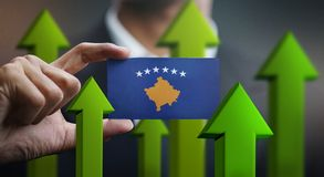 Nation Growth Concept, Green Up Arrows - Businessman Holding Car. D of Kosovo Flag vector illustration