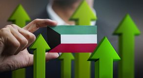 Nation Growth Concept, Green Up Arrows - Businessman Holding Car. D of Kuwait Flag royalty free illustration