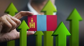 Nation Growth Concept, Green Up Arrows - Businessman Holding Car. D of Mongolia Flag vector illustration