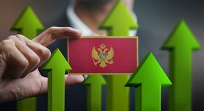Nation Growth Concept, Green Up Arrows - Businessman Holding Car. D of Montenegro Flag royalty free illustration