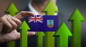 Nation Growth Concept, Green Up Arrows - Businessman Holding Car. D of Montserrat Flag royalty free illustration