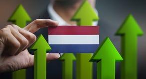 Nation Growth Concept, Green Up Arrows - Businessman Holding Car. D of Netherlands Flag stock illustration