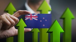 Nation Growth Concept, Green Up Arrows - Businessman Holding Car. D of New Zealand Flag royalty free illustration
