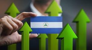Nation Growth Concept, Green Up Arrows - Businessman Holding Car. D Nicaragua Flag stock illustration