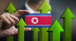 Nation Growth Concept, Green Up Arrows - Businessman Holding Car. D of North Korea Flag stock illustration