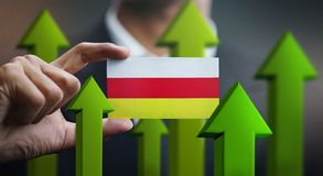 Nation Growth Concept, Green Up Arrows - Businessman Holding Car. D North Ossetia-Alania Flag vector illustration